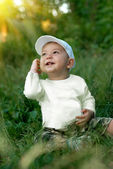 The boy under the sun — Stock Photo