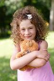 Beautiful girl embraces a teddy bear — Stock Photo
