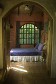 Bedroom through arched doorway — Stock Photo