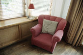 Armchair by window — Stock Photo