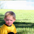 Little boy in yellow playing at park — Stock Photo