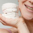 Stock Photo: Smile with bracket & plaster jaw model