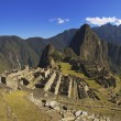 Machu Picchu in the soft morning sun - Stock Photo