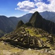 Machu Picchu in the afternoon harsh sun - Stock Photo