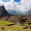 Wayna Picchu and Three Doorway group of ruins - Stock Photo