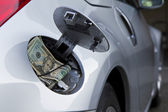 Car, gas cap and money — Stock Photo