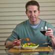 Stock Photo: Salad, wine and middle age man