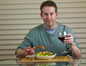 Salad, wine and middle age man — Stock Photo