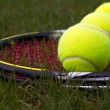 Stock Photo: Tennis Equipment on Natural Grass