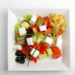 Feta salad with tomatoes and black olives — Stock Photo