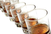 A row of whisky glasses — Stock Photo