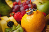 Wedding ring on an orange — Stock Photo