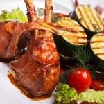 Lamb meat with garnish — Stock Photo #5357936