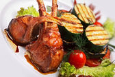 Lamb meat with garnish — Stock Photo