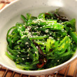 Salad with seaweed with sauce - Photo
