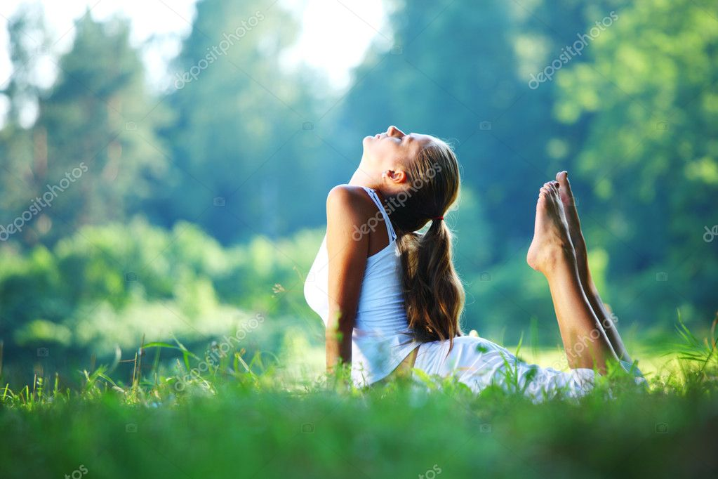 Yoga woman on green park background — Stock Photo #4679462