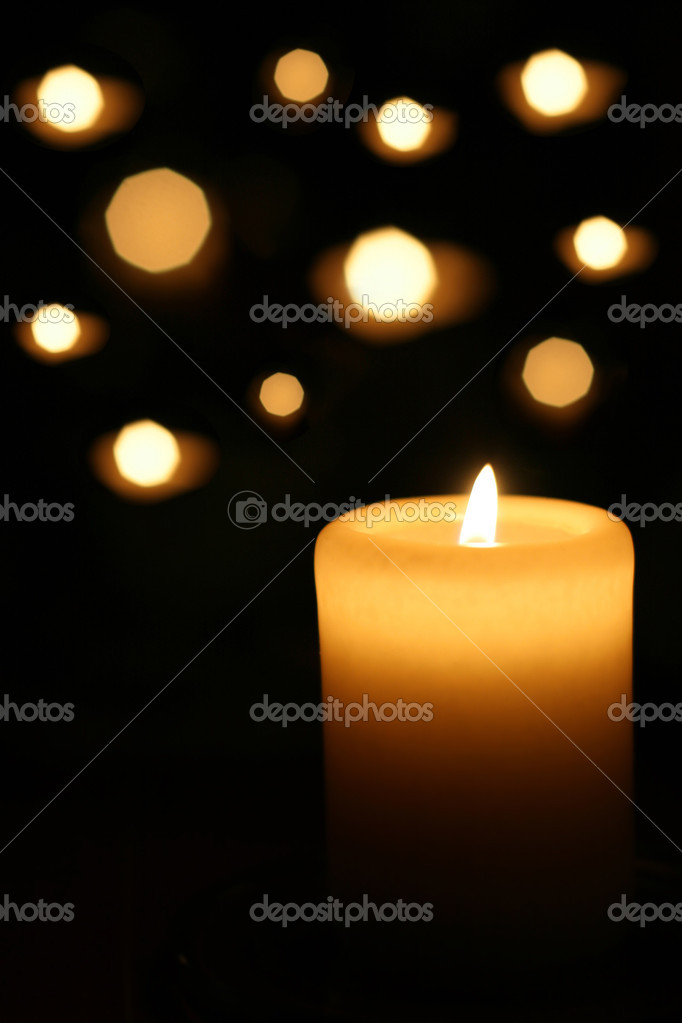 Sacred candles in dark on black background — Stock Photo #4743421