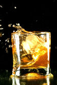 Whisky-splash — Stockfoto