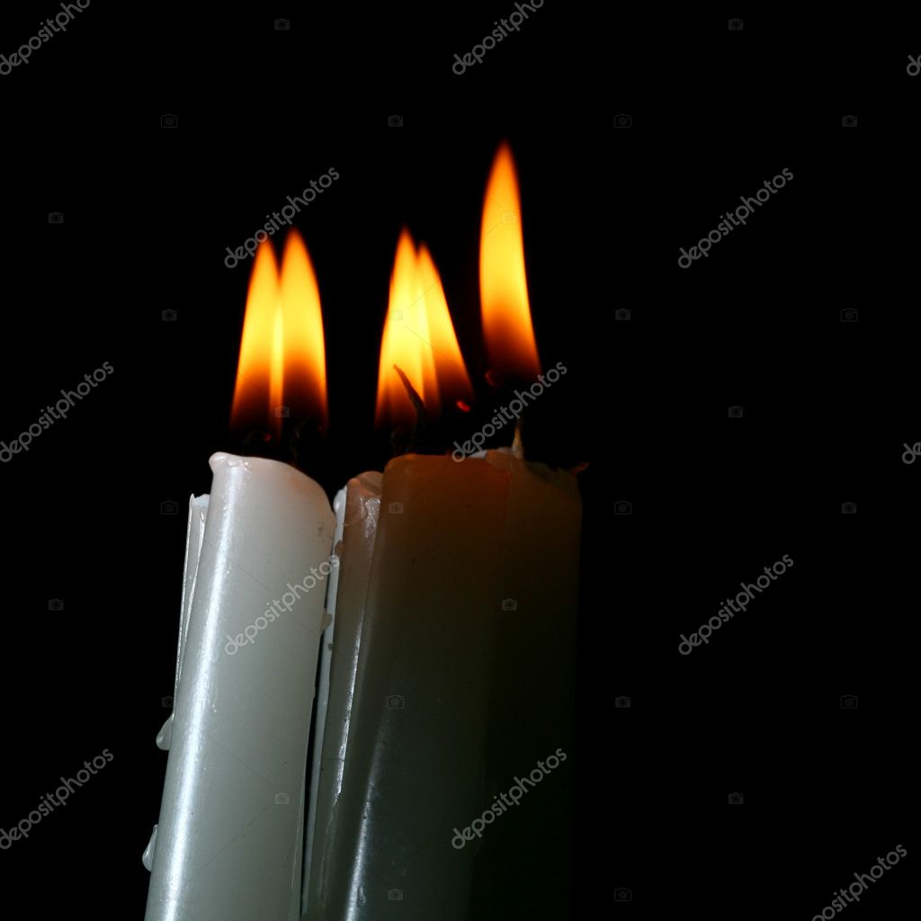 Sacred candles in dark on black background — Stock Photo #4938138