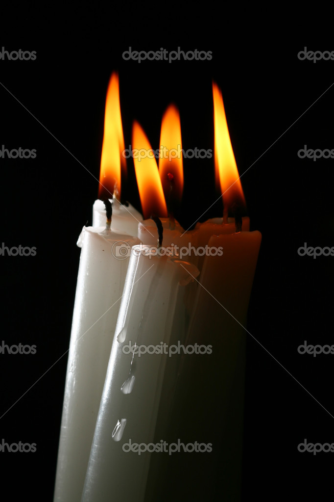 Sacred candles in dark on black background — Stock Photo #4938139