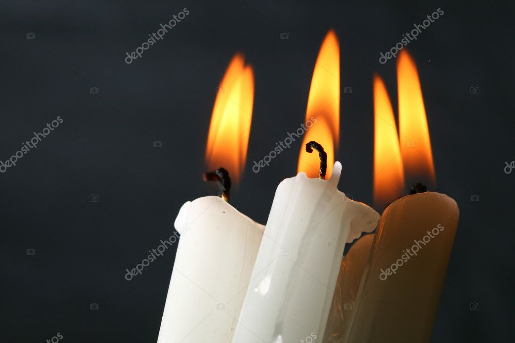 Sacred candles in dark on black background  Stock Photo #4938143