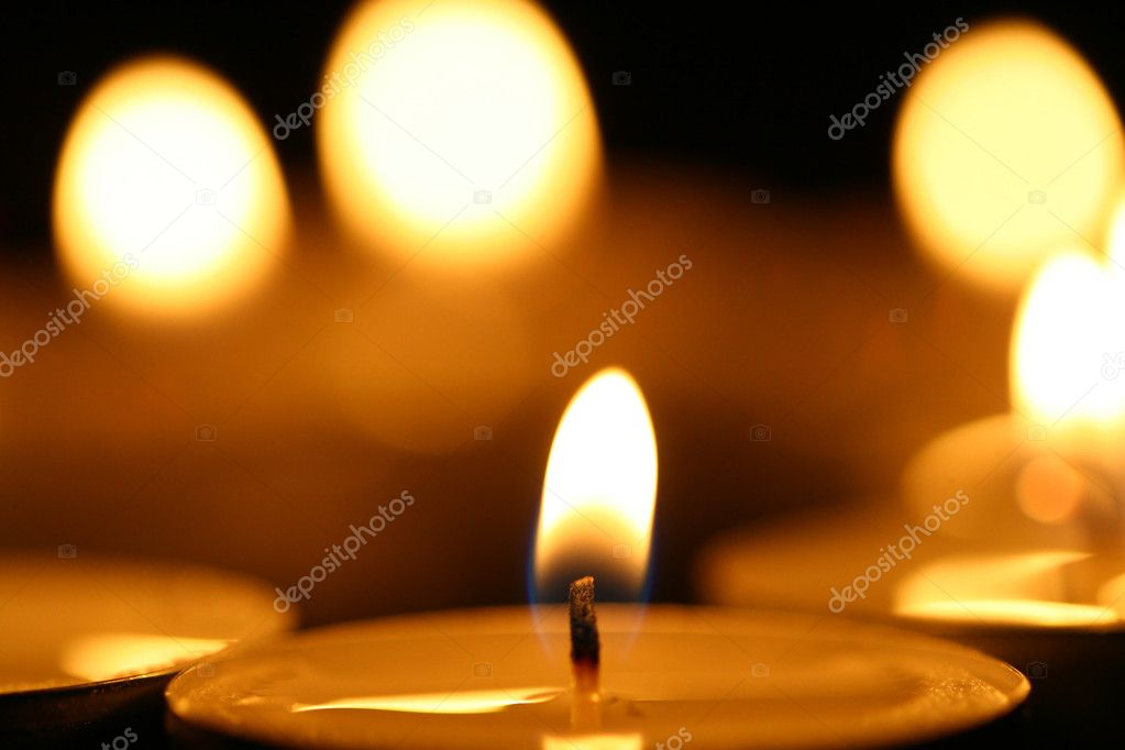 Sacred candles in dark on black background — Stock Photo #4972975