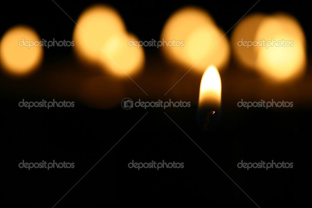 Sacred candles in dark on black background  Stock Photo #4972981