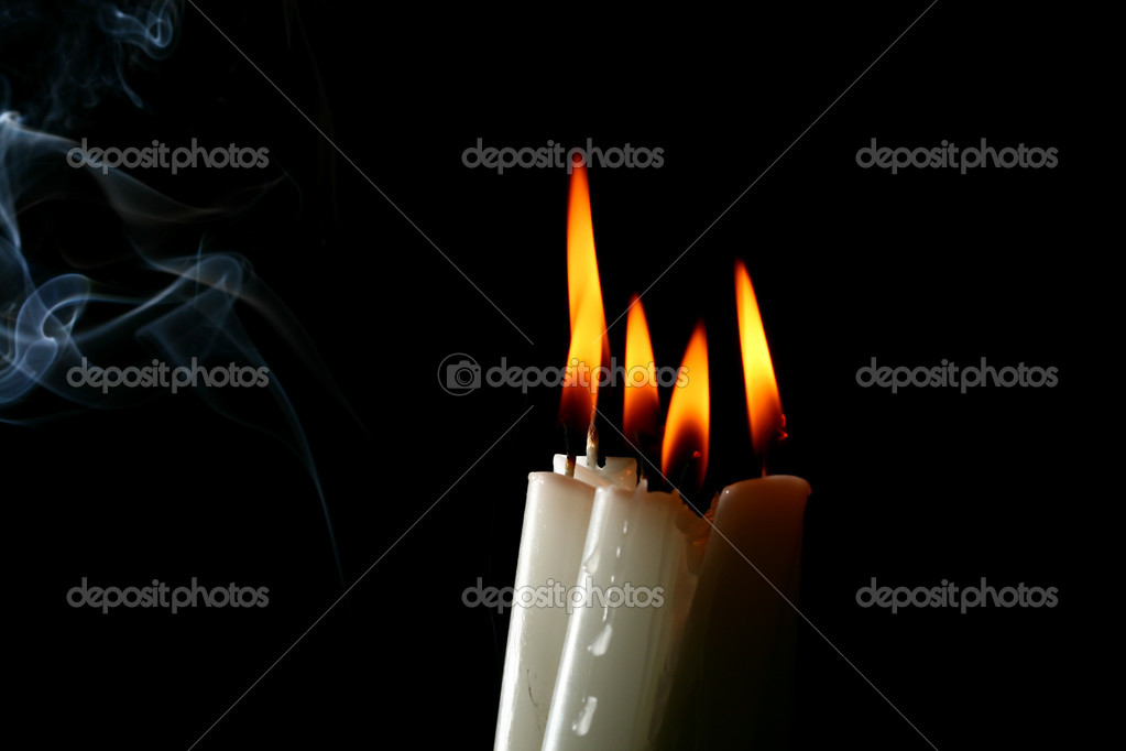 Sacred candles in dark on black background — Stock Photo #5194283