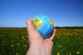 Globe in hand — Stock Photo