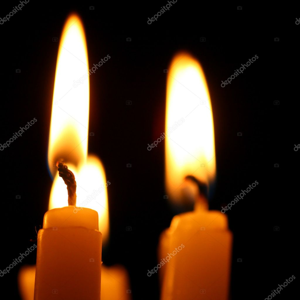 Sacred candles in dark on black background  Stock Photo #5257358
