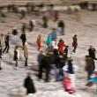Stock Photo: Winter skating rink in evening with moving