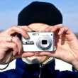 Stock Photo: Mwith compact camerin winter
