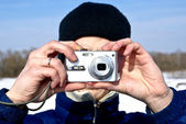 Man with compact camera in winter — Stock Photo