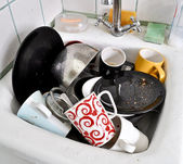 The dirty dishes in the sink — Stock Photo
