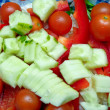Vegetable salad from cucumbers, pepper, tomatoes, onions — Stock Photo