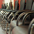 Black leather office chair close-up — Stok fotoğraf