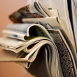 Stock Photo: Folded and crumpled newspapers and magazines in wall bracket