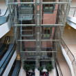Glass elevator shaft in a modern office building - Stock Photo
