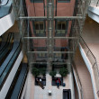 Glass elevator shaft in a modern office building — ストック写真