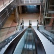 Stock Photo: Glass elevator shafts, escalators in a modern office building