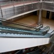 Stok fotoğraf: Glass elevator shafts, escalators in modern office building