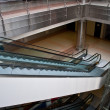ストック写真: Glass elevator shafts, escalators in modern office building