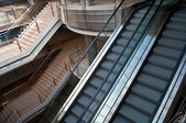 Escalators and stairs in a modern office building — Stock Photo