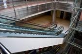 Glass elevator shafts, escalators in a modern office building — Stock Photo