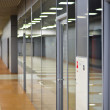 Wall with glass partitions and doors in office building — Stock Photo