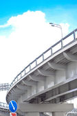 Automobile overpass on background of blue sky with clouds. botto — Stock Photo