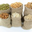 Royalty-Free Stock Photo: Nuts and seeds in burlap bags.