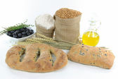 Mediterranean olive breads and raw products. — Stock Photo