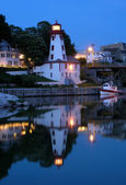 Lighting house and marina caanel night view. — Stock Photo