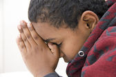 A Young kid praying — Stock Photo